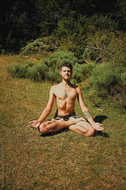 miguel meditating by Paul Schlemmer for Stocksy United