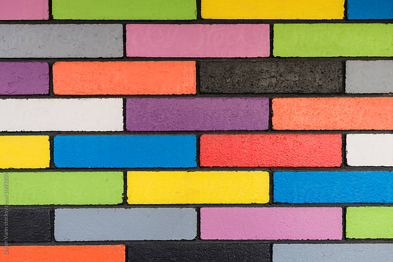 background image of colourful brick wall by Gillian Vann for Stocksy United