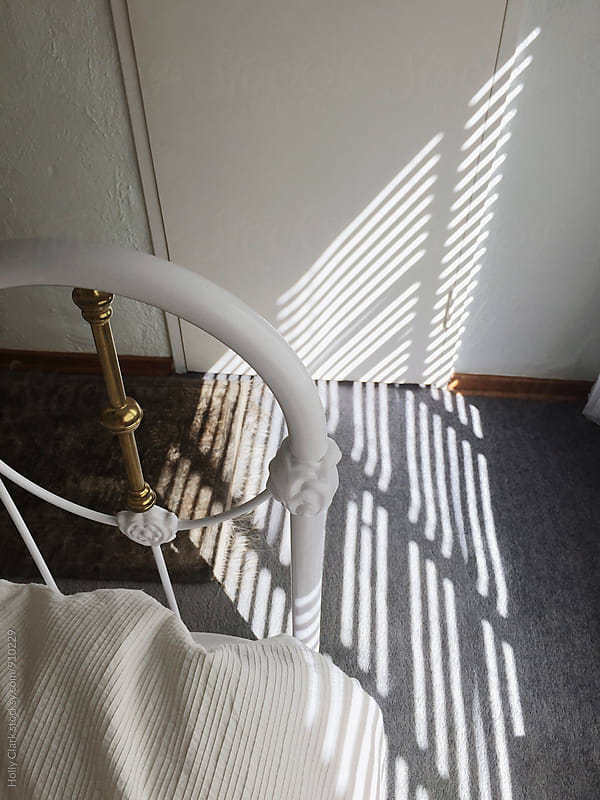 Sunlight on carpet by Holly Clark for Stocksy United