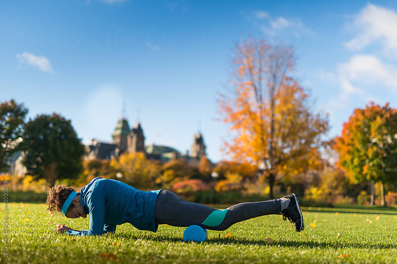 Young Woman Stretching After Jogging In Ottawa Park Near Parliament Hill by JP Danko for Stocksy United