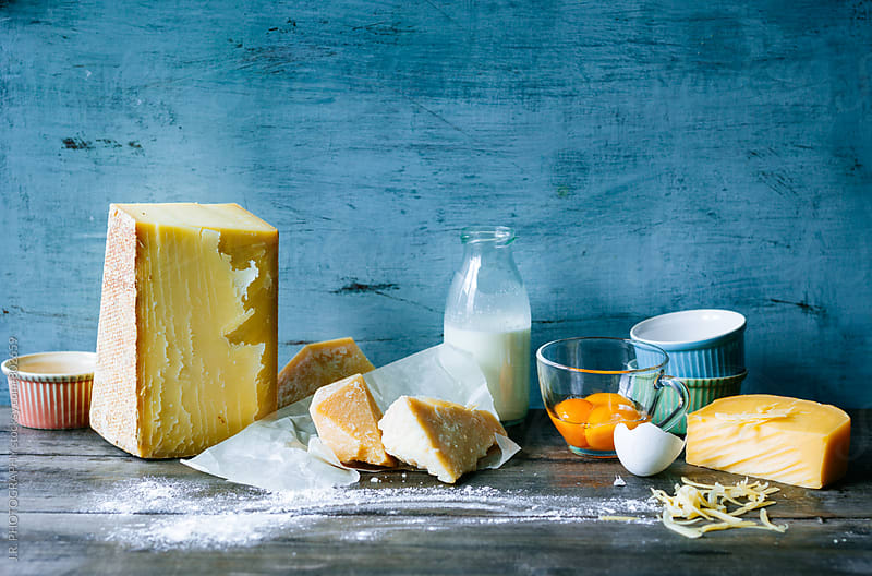 Dairy products on wooden table in the kitchen by J.R. PHOTOGRAPHY for Stocksy United