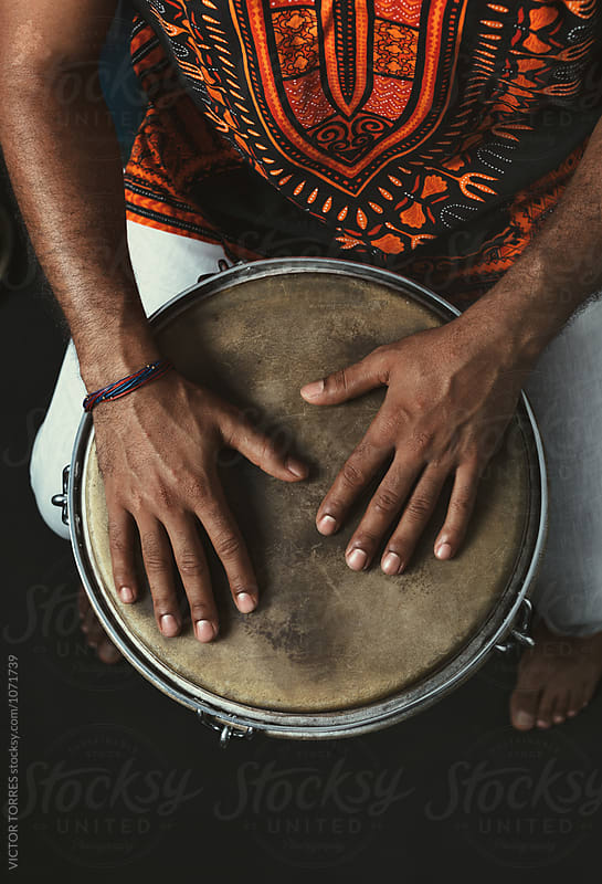Percussionist Playing Bata Drums by Victor Torres for Stocksy United