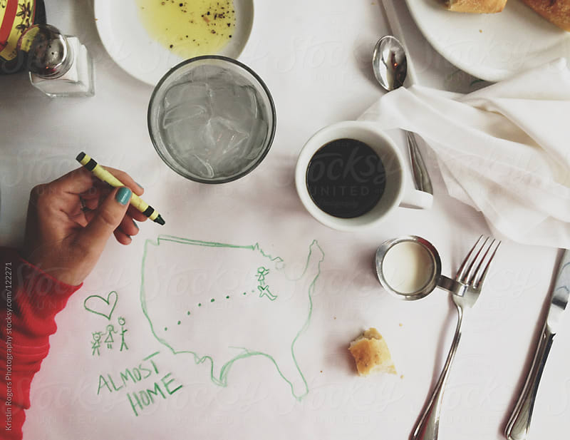 Doodling a map on paper while traveling by Kristin Rogers Photography for Stocksy United