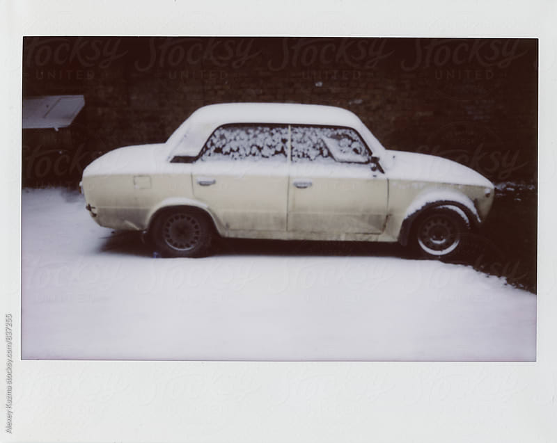 old car covered in Snow by Vesna for Stocksy United