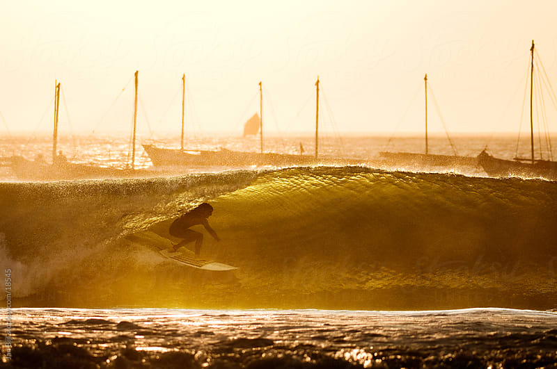 surfer in barreling wave in the port of lobitos, Peru by Jan Bijl for Stocksy United