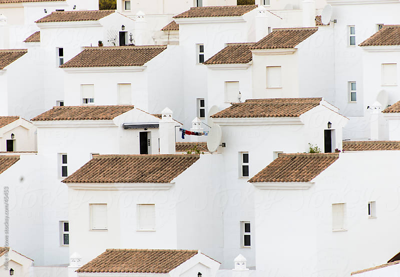 Rows of identical, white walled houses. by Mike Marlowe for Stocksy United