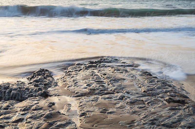 Waves reaching shore at beach by Marilar Irastorza for Stocksy United