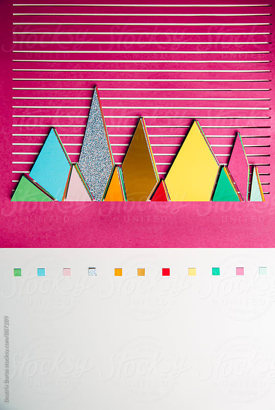 Colorful 3D graphs cut out of paper on striped background by Beatrix Boros for Stocksy United