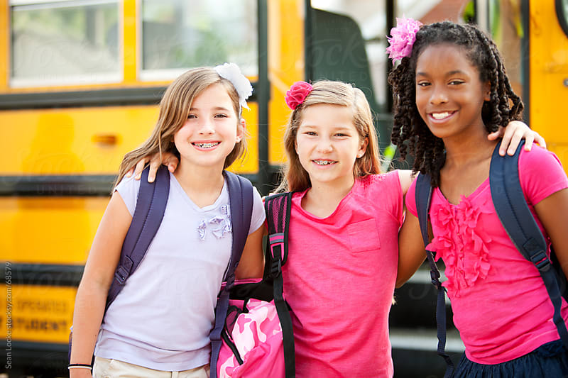 School Bus: Three Girls Hanging Out by Sean Locke for Stocksy United