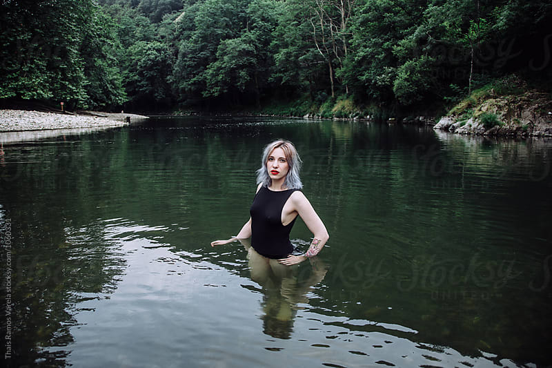 woman bathing in the river by Thais Ramos Varela for Stocksy United