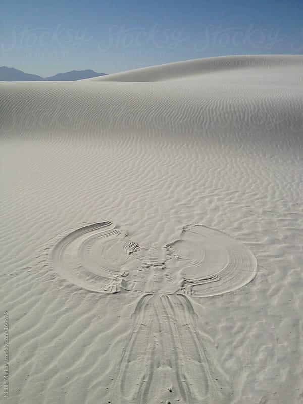 Sand angel made at White Sands, New Mexico by Nicole Mlakar for Stocksy United