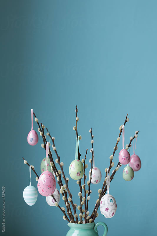 Easter eggs hanging from pussy willow branches by Ruth Black for Stocksy United