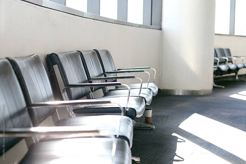 Empty seats at an airport by Jennifer Brister for Stocksy United