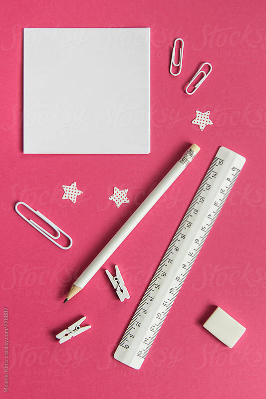 White office utensils on pink background by Melanie Kintz for Stocksy United