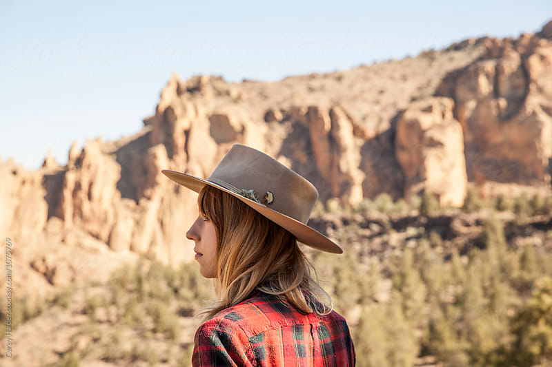 Portrait Of A Woman In A Hat In A Desert by Carey Haider for Stocksy United
