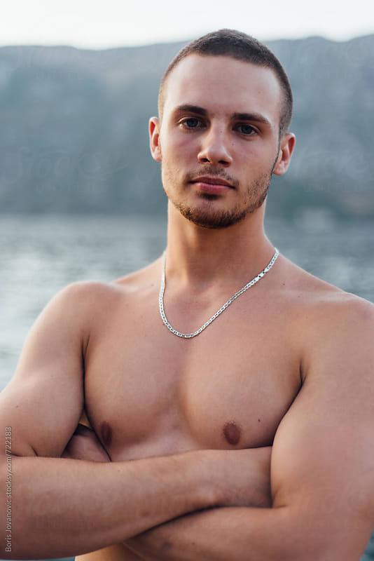 Portrait of topless muscular man  by Boris Jovanovic for Stocksy United