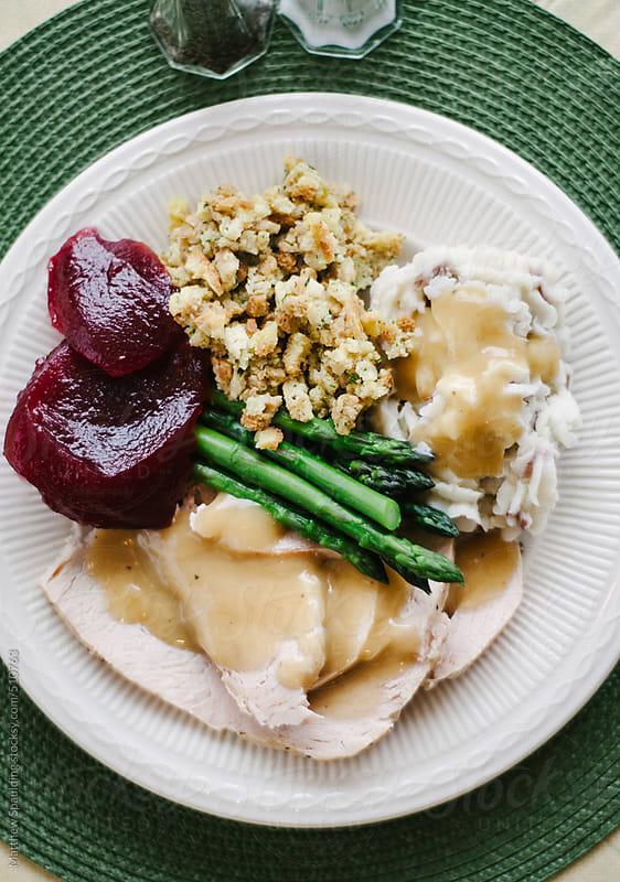 Turkey thanksgiving dinner meal on plate by Matthew Spaulding for Stocksy United