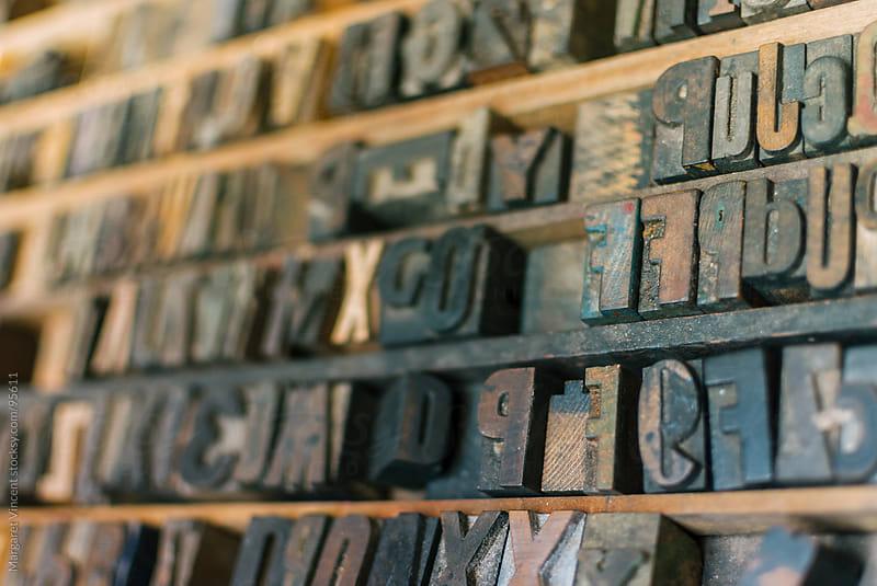letter blocks for typesetting by Margaret Vincent for Stocksy United