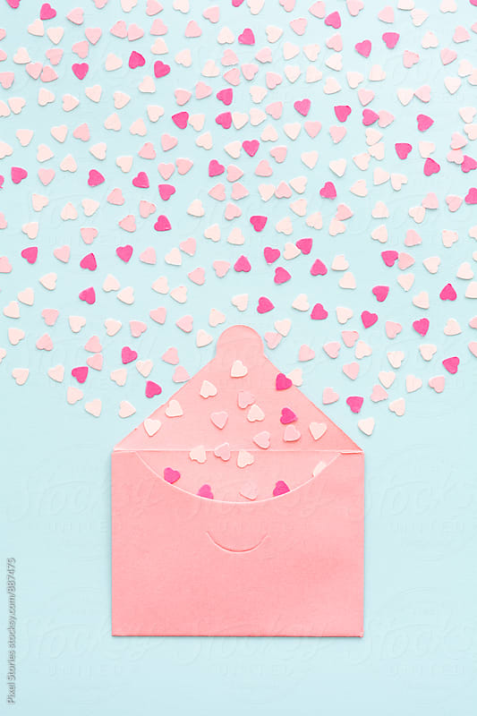 Exploding pastel pink heart confetti from envelope by Pixel Stories for Stocksy United