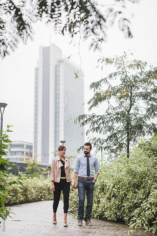 Couple walking outdoor by Mauro Grigollo for Stocksy United