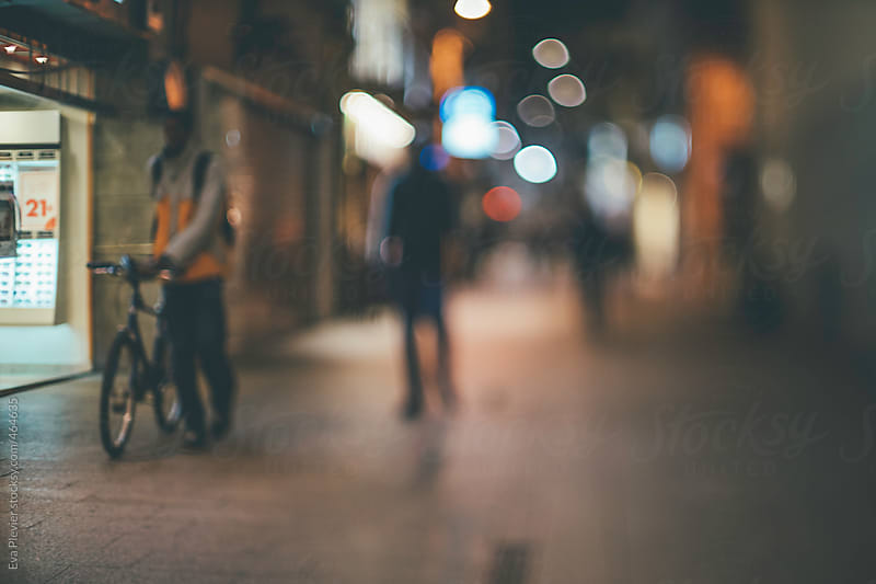 Unfocused people walking down the streets. by Eva Plevier for Stocksy United