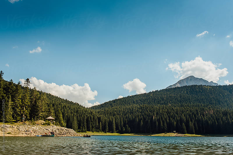 Beautiful mountain lake with mountains and forest in the background by Boris Jovanovic for Stocksy United