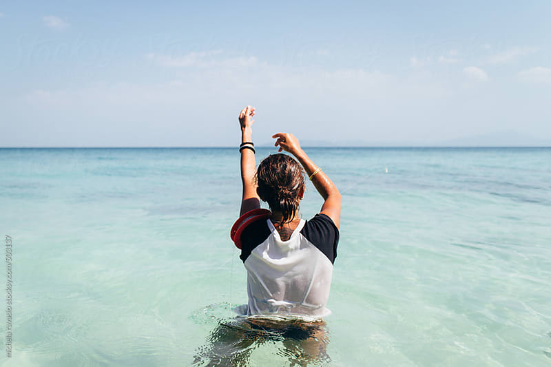 Woman fishing in the sea by michela ravasio for Stocksy United