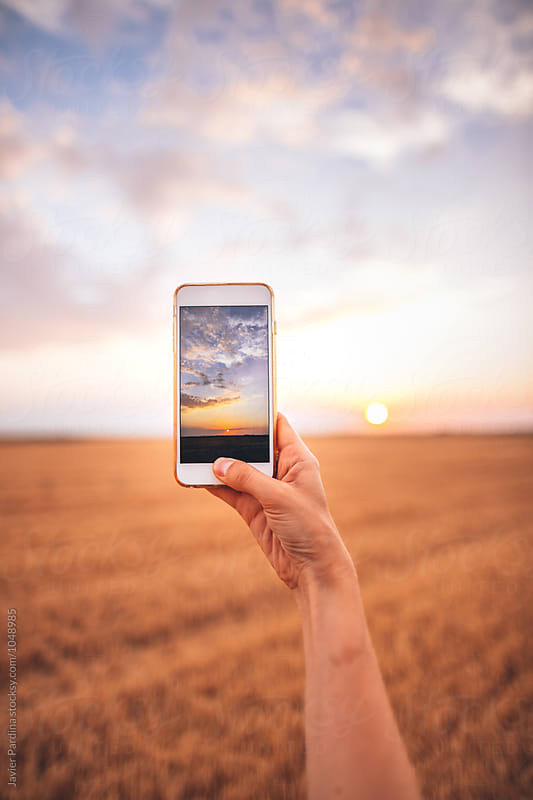 taking photo of sky at sunset by Javier Pardina for Stocksy United