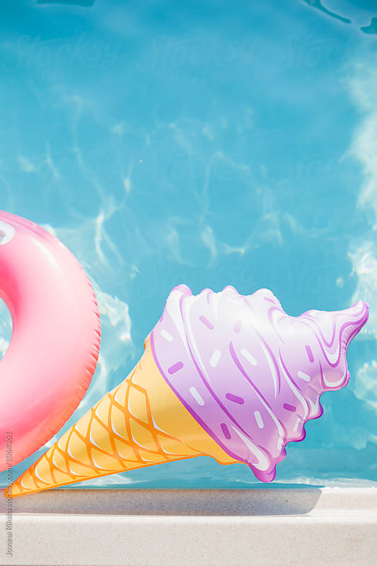 Ice cream float in a pool by Jovana Rikalo for Stocksy United