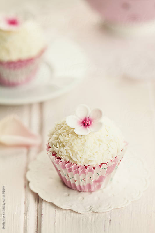 Coconut cupcake by Ruth Black for Stocksy United