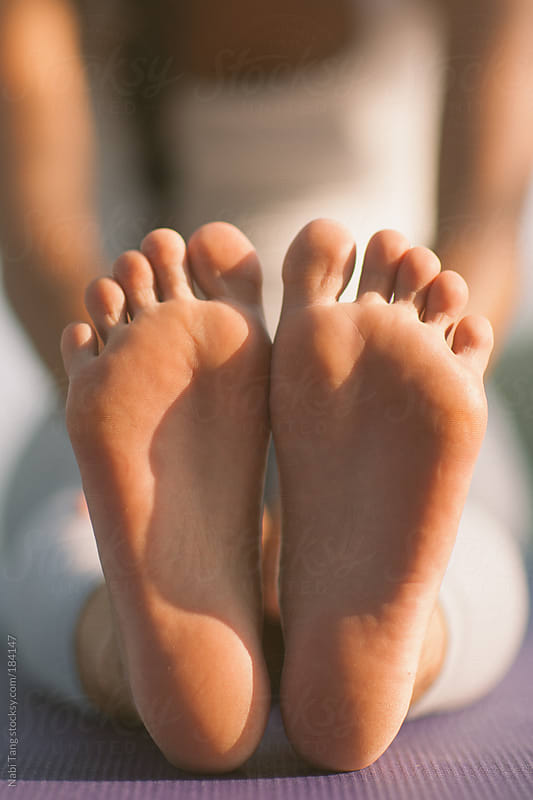 Woman doing yoga - closeup of her bare feet by Nabi Tang for Stocksy United
