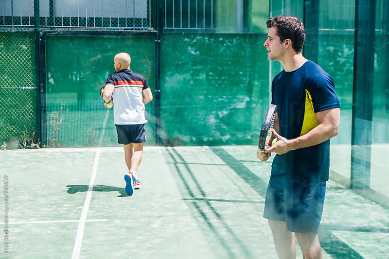 Two men playing paddle tennis by Inuk Studio for Stocksy United