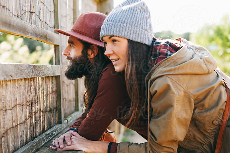 Hipster couple looking a wetland on a sunny day. by BONNINSTUDIO for Stocksy United