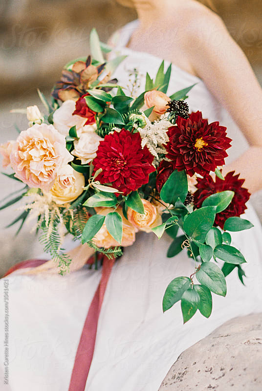 A woman holding a beautiful lush flower bouquet.  by Kristen Curette Hines for Stocksy United