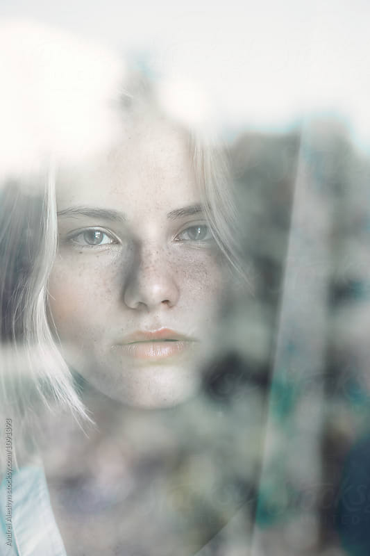 portrait of a beautiful girl at the window glass by Andrei Aleshyn for Stocksy United