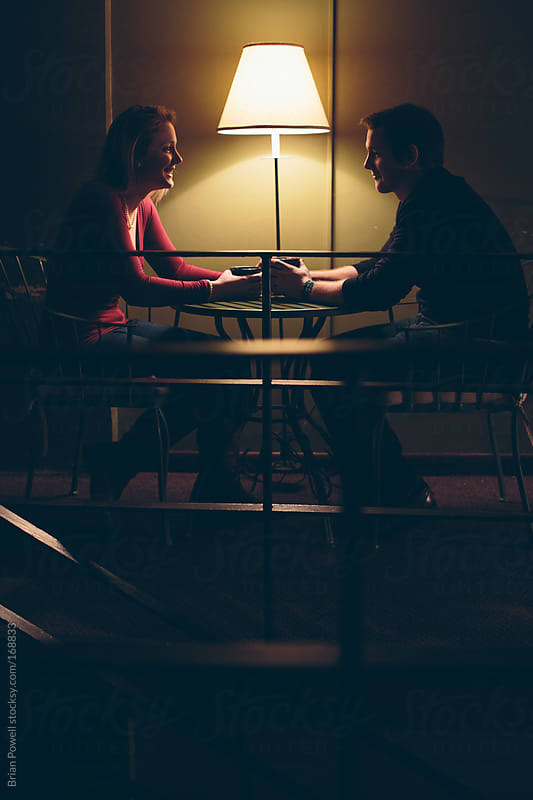 conversation with young couple by Brian Powell for Stocksy United