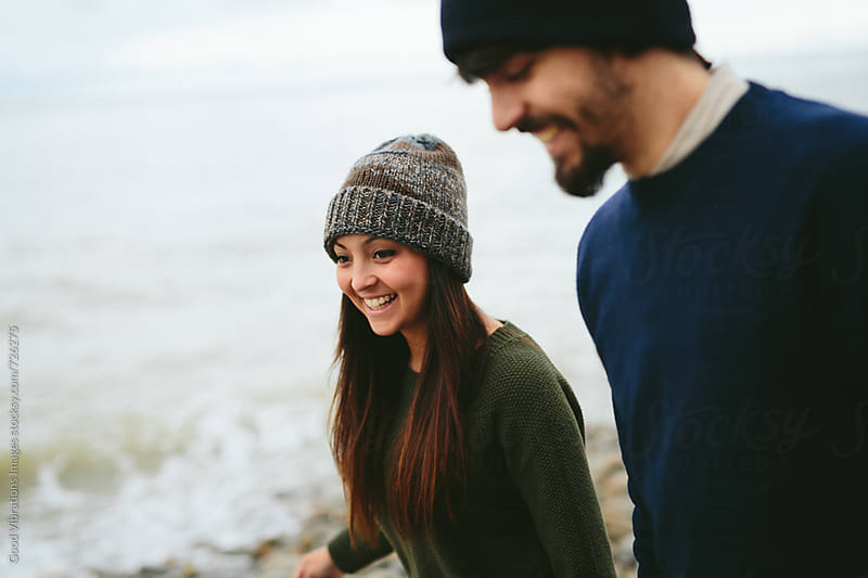 Couple walking on the beach in autumn by Good Vibrations Images for Stocksy United
