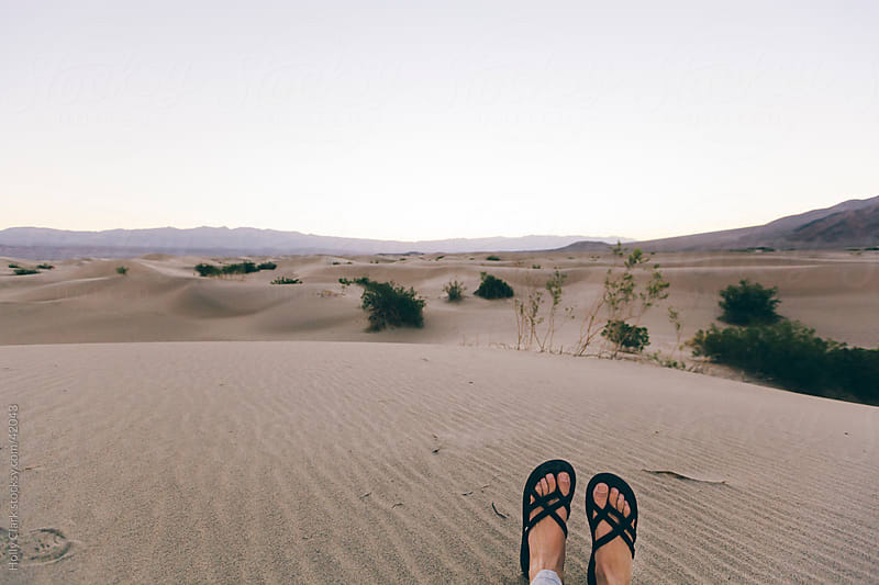 Woman's Feet Relaxing in Desert Sand by Holly Clark for Stocksy United