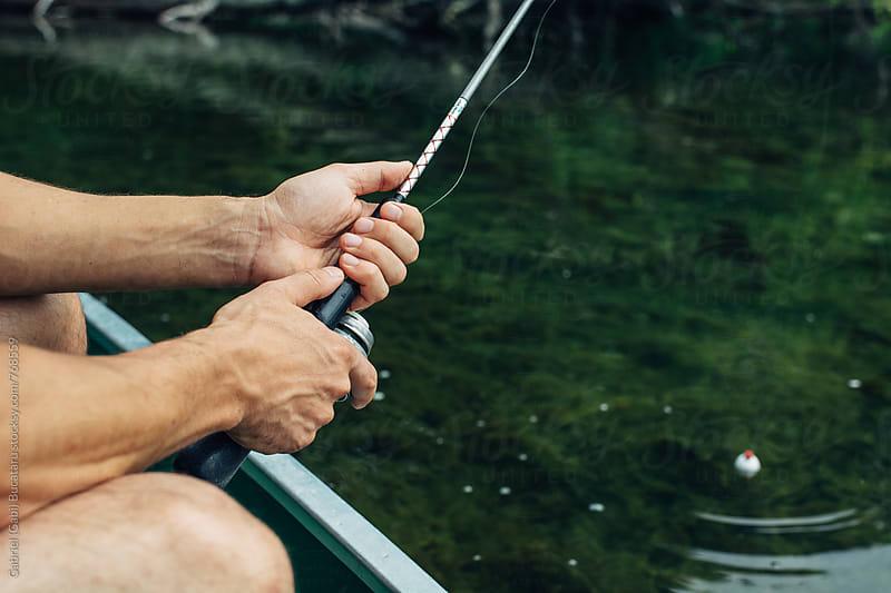 Hands of a man fishing by Gabriel (Gabi) Bucataru for Stocksy United