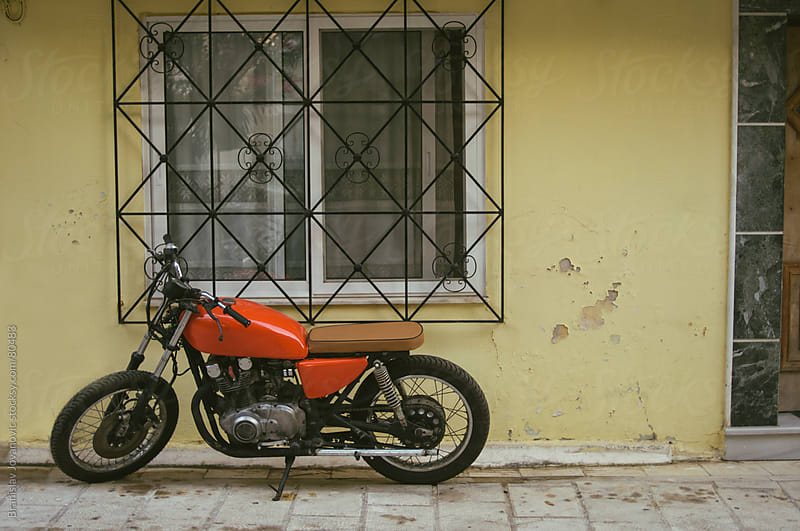 Red Motorcycle On the Street by Branislav Jovanović for Stocksy United