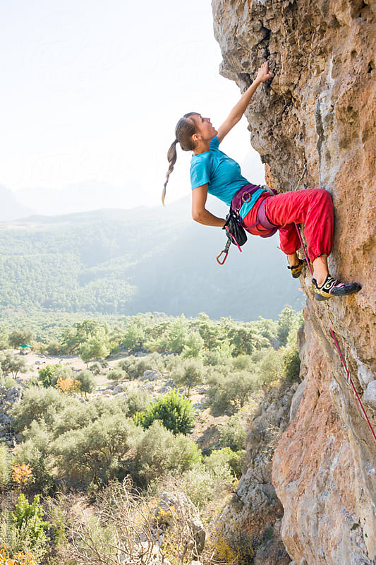 Young woman rock climbing in summer by RG&B Images for Stocksy United