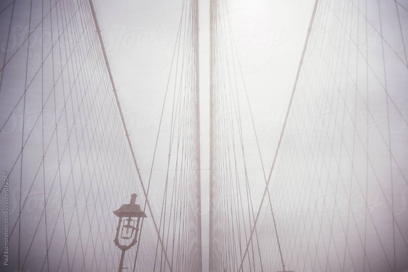 View of cables from Brooklyn Bridge with dense fog, NY, NY, USA by Paul Edmondson for Stocksy United