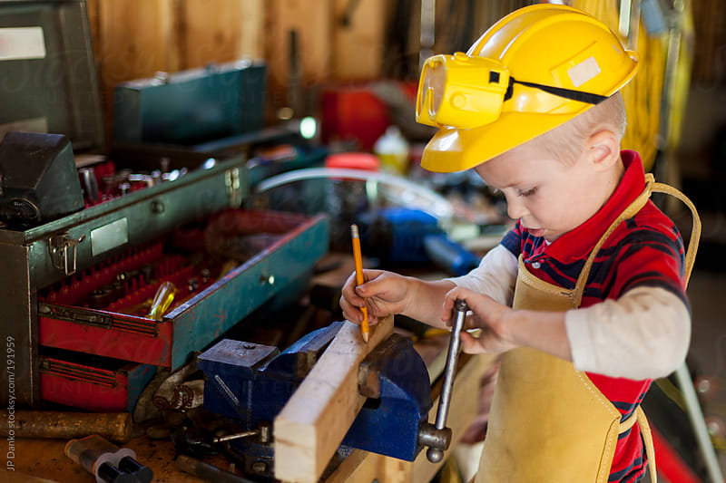 Little Boy Working In Garage With Hand Tools by JP Danko for Stocksy United
