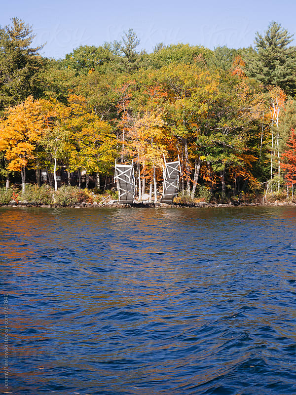 Docks and foliage on the lake. New Hampshire by Jeremy Pawlowski for Stocksy United