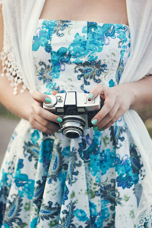 Girl holding an old retro camera in her hands by Jovana Rikalo for Stocksy United