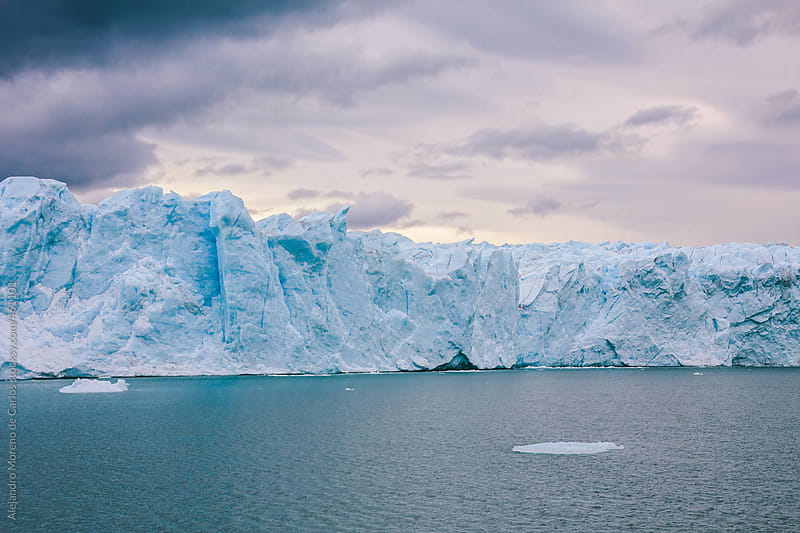 Ice wall of a glacier at sunset. Perito Moreno glacier, Argentina, Patagonia by Alejandro Moreno de Carlos for Stocksy United