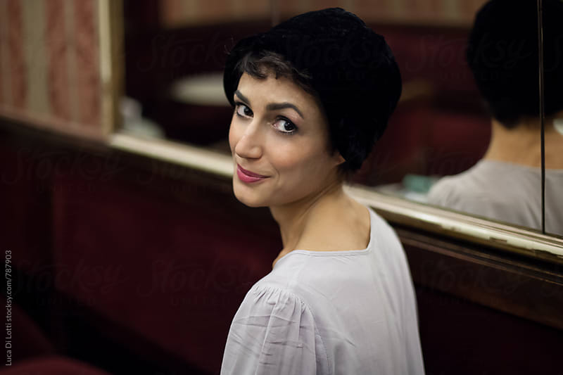 Portrait of a beautiful greek woman wearing a vintage black hat. by Luca Di Lotti for Stocksy United