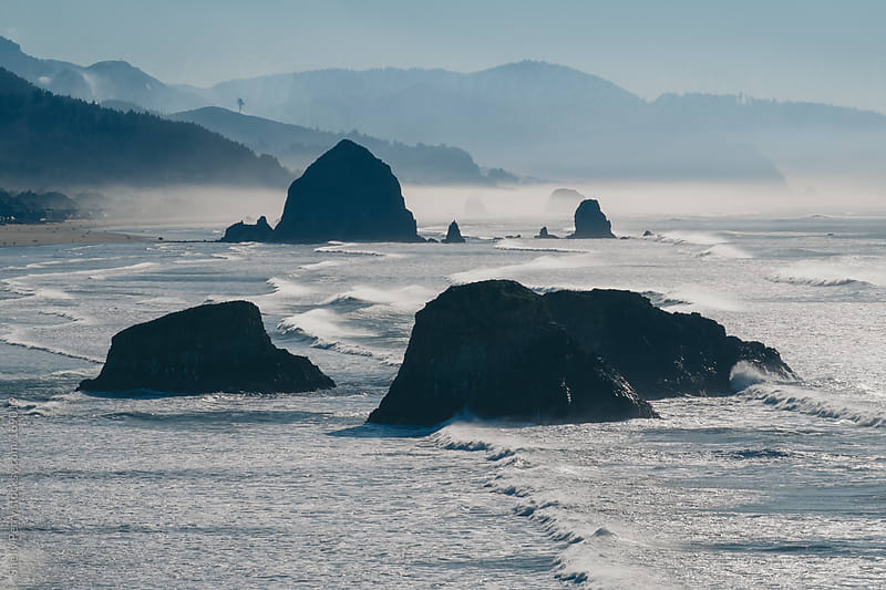 Haystack Rock in the distance at Scenic Canon Beach, Oregon by Shelly Perry for Stocksy United