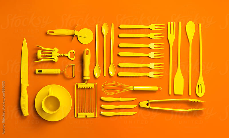 Well organised yellow kitchen objects on orange background. by Audrey Shtecinjo for Stocksy United