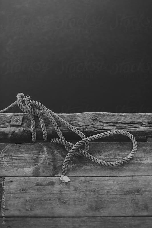 Rope with knot on jetty by Jonas Räfling for Stocksy United